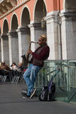 Street musician performing in Massena square, Nice, France Royalty Free Stock Images