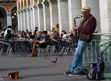 Street musician performing in Massena square, Nice, France royalty free stock photo