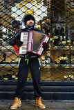 Street musician playing accordion Stock Image