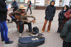 Street musician playing on the Arbat street Moscow Royalty Free Stock Image