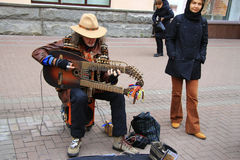 Street musician playing on the Arbat street Moscow Stock Photos