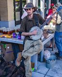 Street Musician Playing a Banjo. Roanoke, VA – September 30th: Street musician entertaining shoppers at the Roanoke City Farmers Market located in Center in Royalty Free Stock Image
