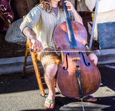 Street musician playing the cello Stock Images