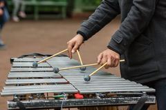 Street musician playing the chromatic glockenspiel metallophone. Hands of street musician playing the chromatic glockenspiel metallophone Royalty Free Stock Photos