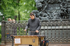 Street musician playing the chromatic glockenspiel metallophone near the monument to Krylov. Saint Petersburg, Russia. Street musician playing the chromatic Royalty Free Stock Photography