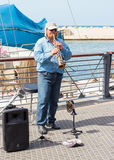 Street musician playing the clarinet on the waterfront in Yafo Stock Images