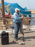 Street musician playing the clarinet on the waterfront in Yafo Royalty Free Stock Photo