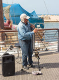 Street musician playing the clarinet on the waterfront in Yafo Royalty Free Stock Photography