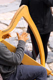 Street Musician Playing Classical Harp Stock Image