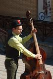 Street musician playing a double bass Royalty Free Stock Image