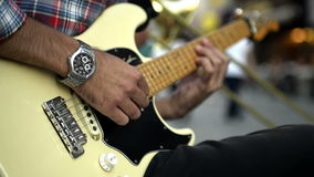 Street musician. Street musician playing an electric guitar stock footage