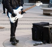 Street musician playing on electric guitar. Unrecognizable person Stock Image