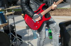 Street musician playing on electric guitar. Unrecognizable person Royalty Free Stock Images