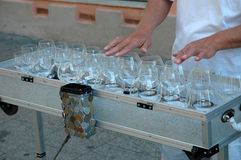 Street musician playing on glass harp Stock Photos