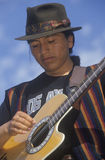 Street musician playing the guitar,. Los Angeles, CA Royalty Free Stock Photography
