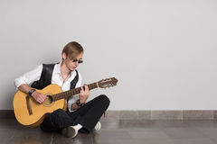 Street musician playing guitar. Street musician playing his guitar Stock Image