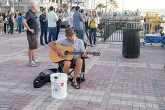 Street Musician at Mallory Square, Key West. A street musician playing guitar at Mallory Square, Key West Stock Photography