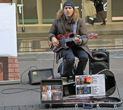 Street musician is playing guitar in outdoor Royalty Free Stock Photos