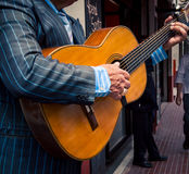 Street musician playing guitar. Street performer playing guitar in Buenos aires Royalty Free Stock Photography