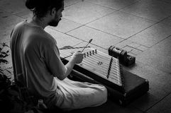 Street Musician Playing Hammered Dulcimer. A street musician playing a hammered dulcimer in Bagdat Avenue - Istanbul. The hammered dulcimer is a stringed musical royalty free stock photos