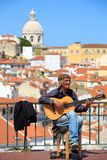 Street musician is playing on his flamenco guitar.
