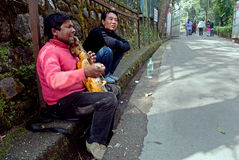 Street Musician. A musician is playing local tune in violin beside a street in Gangtok, Sikkim, India Stock Photo