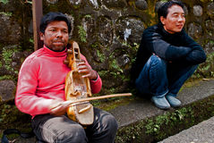 Street Musician. A musician is playing local tune in violin beside a street in Gangtok, Sikkim, India Stock Image