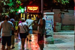 Street Musician At Night In Cinarcik Town - Turkey royalty free stock photo
