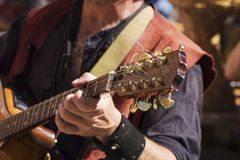Street musician playing Royalty Free Stock Photography