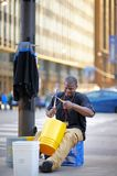 Street musician playing rhythmical music using plastic pails on Michigan Avenue in Chicago on April 24, 2015 Stock Photos