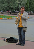 Street musician is playing saxophone outdoor in Chelyabinsk, Russia Royalty Free Stock Photos