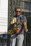 Street musician playing saxophone on the street Royalty Free Stock Images