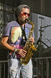 Street musician playing saxophone on the street Royalty Free Stock Photos