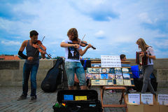 Street musician. Playing violin and instrument on the street Royalty Free Stock Photo