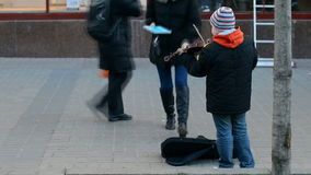 A street musician playing the violin stock footage