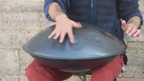The street musician plays a metal drum stock video
