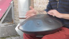The street musician plays a metal drum stock video footage