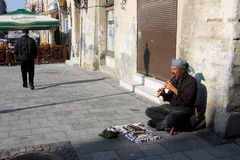 Street musician plays music outdoor Stock Image