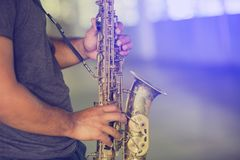 A street musician plays the saxophone royalty free stock photo