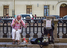 Street musician in Saint Petersburg, Russia. Royalty Free Stock Image