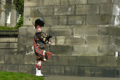 Street musician - senior bagpiper in Edinburgh Royalty Free Stock Images