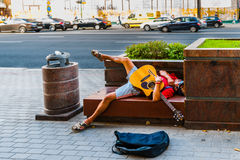 Street musician sleeps on the bench Royalty Free Stock Photo