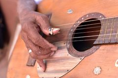 Street musician in Trinidad. Cuban musician playing guitar music on the street, Trinidad, Cuba stock images