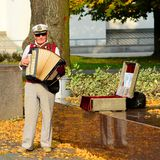 Street musician in Vilnius city cathedral place Royalty Free Stock Photography