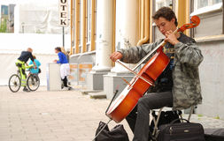 Street musician with violoncello. Royalty Free Stock Photo