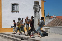 Street musicians. Portuguese Street musicians acting in the streets of Obidos Royalty Free Stock Photography