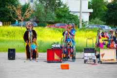 Street musicians in American Indian costumes. Moscow - June 9: Street musicians in American Indian costumes, Mitinskaya street, Russia, Moscow, June 9, 2014 Royalty Free Stock Photo