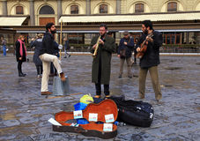 Street musicians band perform in the street at Florence stock photos