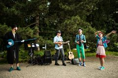 Street musicians band performing in a park. Street musicians band performing in the Herastrau Park, Bucharest, Romania, in the summer Royalty Free Stock Image