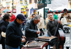Street musicians in Brussels. Street musicians playing with musical instruments in Brussels Stock Image